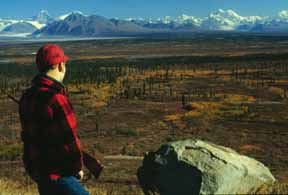 A hunter overlooks the Monahan Flat off the Denali Highway in Southcentral Alaska